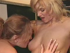 Lesbians get it on in the kitchen