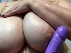Horny granny playing with her boobs