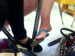 Girl dangling sandals in class