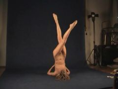 Flexible naked teenager in the photo studio
