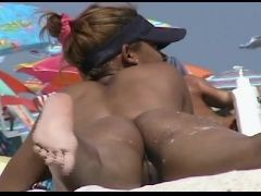 Amazing beach voyeur vid of two nudist girls and their wet pussies