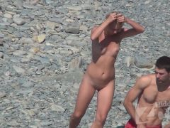 Sexy women undress on a nude beach on spy cam