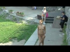 Naked girl with small tits walks the park