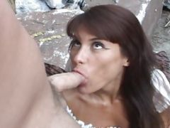 Black-haired Starlet Blows A Masculine Guy Outdoors