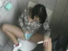 She masturbates while on the toilet