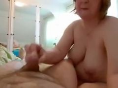 chubby older woman giving an hand job in advance of this babe rides his dong