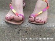 Hot blonde takes sandals off in Public