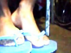 Blue Sandals On Hot Black Feet Under The Table