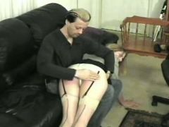 A-cup cutie, spanked and paddled by stud and woman.