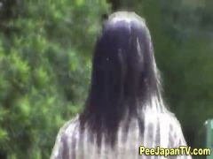 Asian girl squats to pee outside