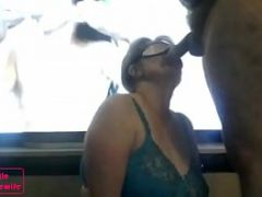 I am a submitted housewife sucking in front of a porno movie