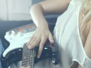 attractive Blond and her guitar