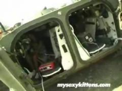 girl with an mp5 masturbate in  aarmored car