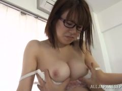 Naked asian  with glasses is swallowing big erection