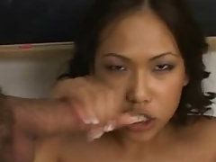 Erotic Brunette Babe Deep Throats A Huge Dick While Hand Job another Dick