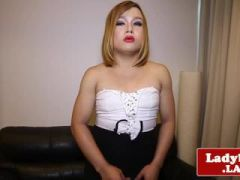 Chubby ladyboy tugging dick on couch