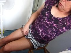 Sitting on my Treasure in a short skirt and Tan Stockings