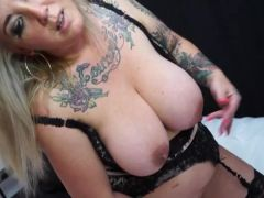 Nasty tattooed mature whore slides a toy up her cunt