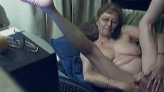 Granny has phone sex and fucks her old pussy