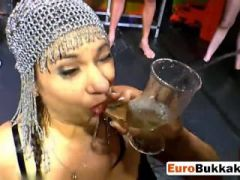 Dirty European slut kneeling in front of few guys and drinking their piss