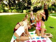 girls playing twister outdoor