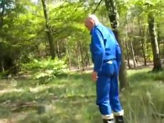nlboots - out in rubber boots and coverall, smoking