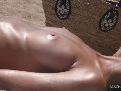 Girls tanning their naked tits on the beach
