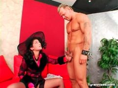 Naked man in submission to clothed girl