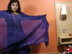 Desi removes her clothes to play with her dildo