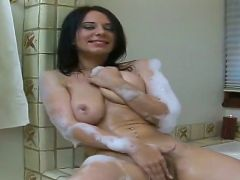 Pretty amateur brunette babe Billy rubs her natural boobs in the bathroom