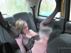 Blonde in stockings gives foot job in cab