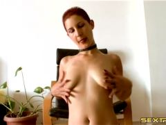 Skinny slut with short red hair plays with her tits