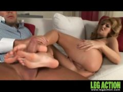 Rock hard cock gets a hot footjob from her