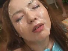 Lovely Japanese sucks and gets covered in cum
