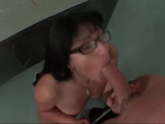 Hot babe with glasses sucking cock in class