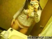 Hot girl strips naked on her cell phone
