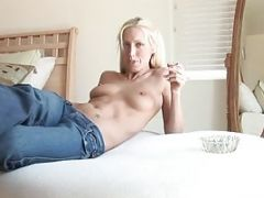 Beautiful Blonde Relaxes Topless In Her Tight Jeans