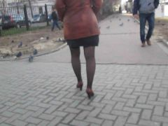 Girl flashing stockings walking on a street