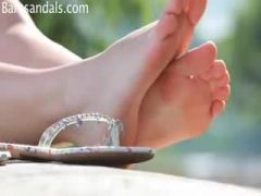 Sexy girl dangling with her white flip flop