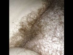 revealing the soft curly pubic hair.