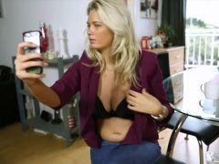 Blonde takes selfies of her amazing tits